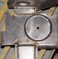 Front truss coil bucket with factory trackbar mount